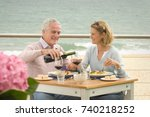 couple dining at seaside... | Shutterstock . vector #740218252
