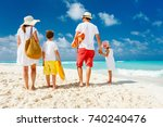back view of a happy family at... | Shutterstock . vector #740240476