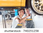 two dedicated auto mechanics... | Shutterstock . vector #740251258
