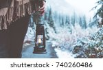 woman traveling among snowy... | Shutterstock . vector #740260486