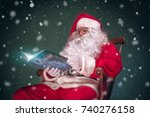 santa claus reading book in...   Shutterstock . vector #740276158