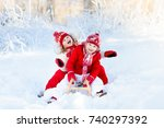 little girl and boy enjoying... | Shutterstock . vector #740297392