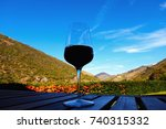 glass of red wine on wood table ... | Shutterstock . vector #740315332