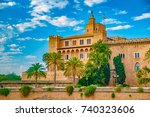 almudaina palace with palm... | Shutterstock . vector #740323606