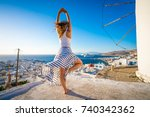 woman training yoga in mykonos  ... | Shutterstock . vector #740342362