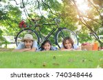 happy asian family picnic lying ... | Shutterstock . vector #740348446