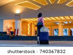 young woman with trolley bag... | Shutterstock . vector #740367832