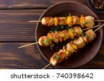 barbecue chicken on skewers. on ... | Shutterstock . vector #740398642