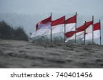 Small photo of The Indonesia flag uncase in the beach