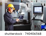 maintenance engineer using... | Shutterstock . vector #740406568