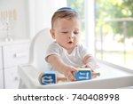 cute baby in kippah playing...   Shutterstock . vector #740408998