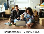 young family moved into a new... | Shutterstock . vector #740424166