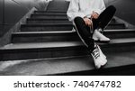 man is sitting on the stairs....   Shutterstock . vector #740474782