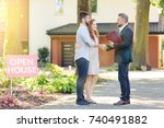 real estate agent welcoming... | Shutterstock . vector #740491882