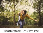fly with mother on piggyback .... | Shutterstock . vector #740494192