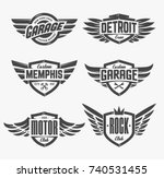 set of retro emblems with wings.... | Shutterstock .eps vector #740531455