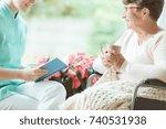 smiling volunteer spending time ... | Shutterstock . vector #740531938