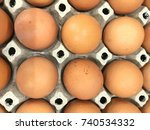 Small photo of group of fresh chicken eggs on paper box background, close up, top view full frame, concept egg benefits nutrient fact healthy food contain high quality protein, essential vitamins and minerals