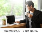 business man holding a coffee... | Shutterstock . vector #740540026