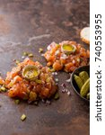 salmon tartare with yolk ... | Shutterstock . vector #740553955