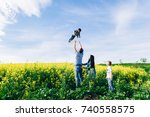 family dad mom and children in... | Shutterstock . vector #740558575