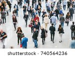 walking crowd of people at a... | Shutterstock . vector #740564236