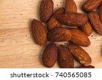 salted   smoked almond in focus ... | Shutterstock . vector #740565085