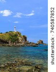 Small photo of Old lighthouse at seaside cliff with blue sky, Ko Lanta (Lanta Island), Krabi Province, Thailand.