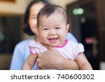the baby is so happy so she... | Shutterstock . vector #740600302