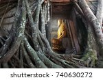 Small photo of Samut Songkhram , Thailand-Oct 2016 , Bang Kung Camp , A wall was built, making a temple, Wat Bang Kung ,Unseen Thailand ,Beautiful Buddha image in a tree temple , 8 October 2016