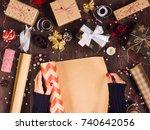 woman hand unfolding roll of... | Shutterstock . vector #740642056