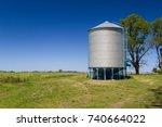 farm grain silo for agriculture. | Shutterstock . vector #740664022