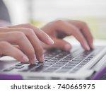 closeup female hands typing on... | Shutterstock . vector #740665975