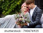 handsome young man hugs tender... | Shutterstock . vector #740676925