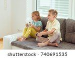 two happy children playing... | Shutterstock . vector #740691535