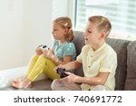 two happy children playing... | Shutterstock . vector #740691772