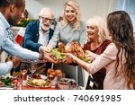 beautiful large family holding... | Shutterstock . vector #740691985