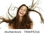 beautiful woman shakes her hair ... | Shutterstock . vector #740695216
