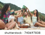 happy people at a party outdoors | Shutterstock . vector #740697838
