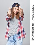 smiling teen girl pointing at... | Shutterstock . vector #740732332