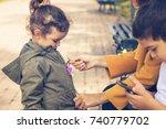 mother zipping up daughter's...   Shutterstock . vector #740779702