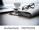 newspaper with computer on... | Shutterstock . vector #740792356