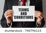 businessman holding a card with ... | Shutterstock . vector #740796115