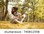 handsome man using mobile smart ... | Shutterstock . vector #740812558
