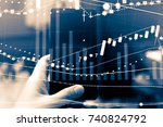financial data on a monitor as... | Shutterstock . vector #740824792