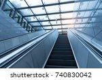 ascending escalator in a public ... | Shutterstock . vector #740830042