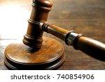wooden gavel hit sound block   Shutterstock . vector #740854906