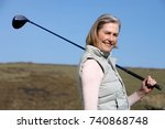 Smiling Senior Woman With Golf...