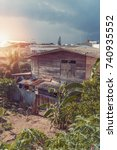 Small photo of Wooden old house in slum area : Thailand