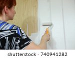 painting the wall at home.  | Shutterstock . vector #740941282